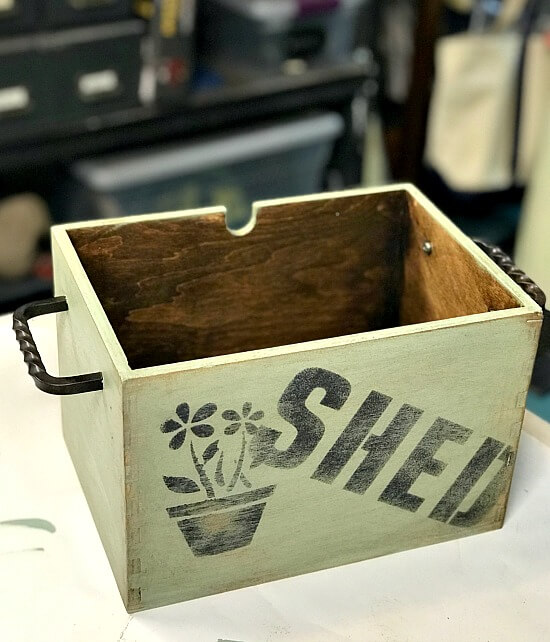 Rustic flower box for flowers with a stenciled Shed design