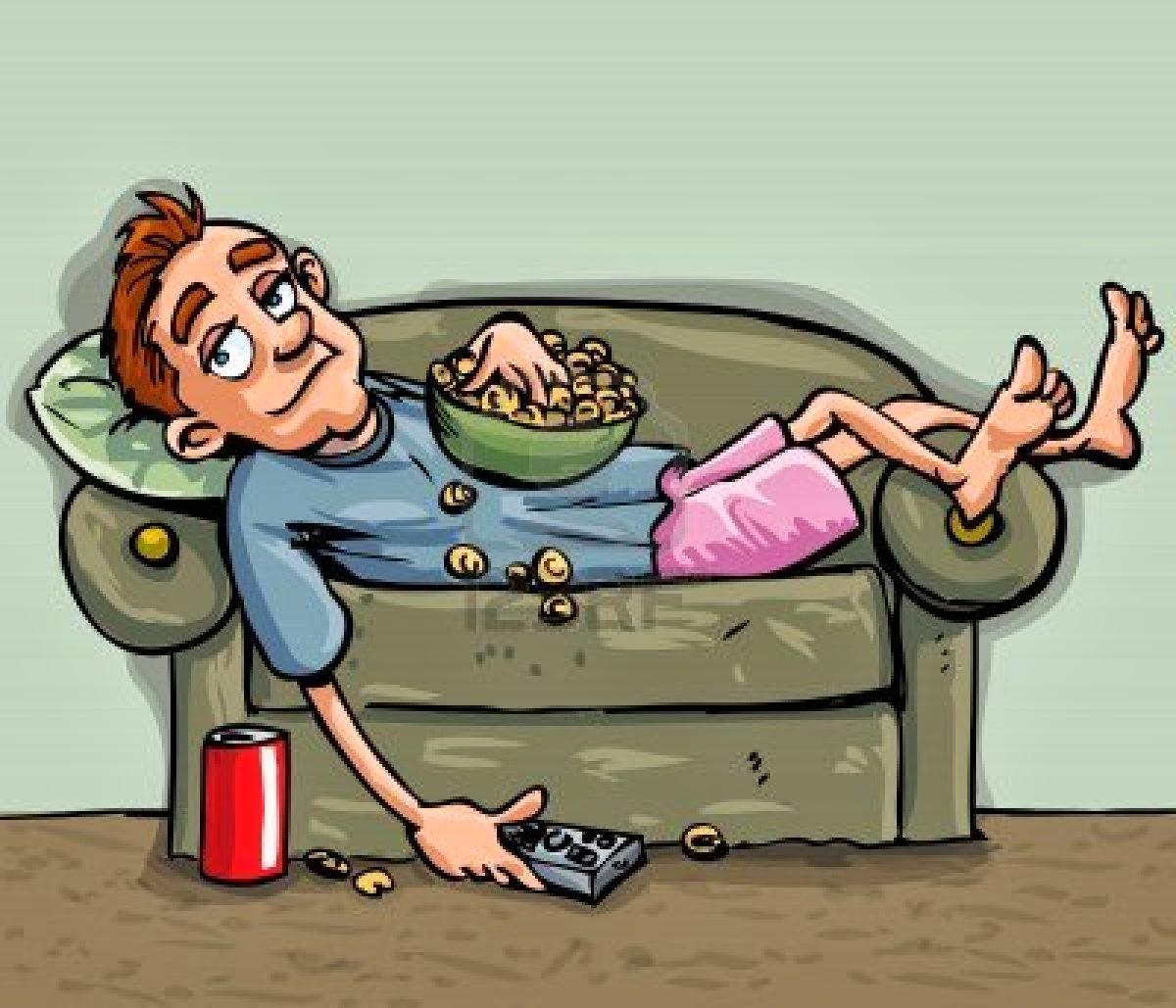 Boy relaxing on sofa, watching TV