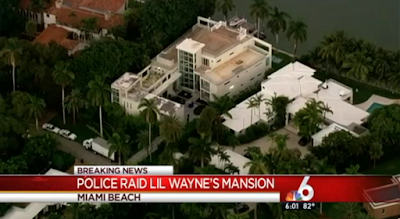 Police raid rapper Lil Wayne's Miami Beach mansion