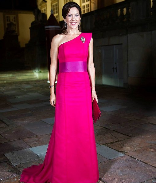 Crown Princess Mary wore David Andersen gown, carried Carlend Copenhagen clutch. Princess Marie wore Bally shoes