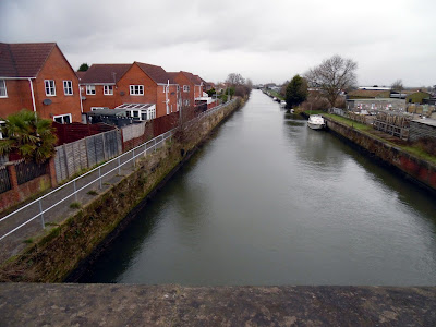 The Waters Edge housing estate beside the New River Ancholme viewed from Cake Mill Bridge in Brigg  - January 2019