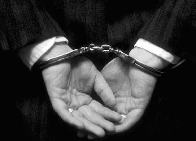 Ex-banker arrested