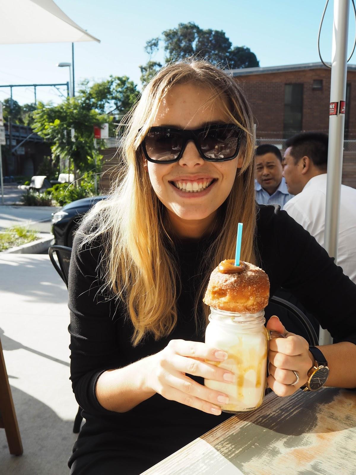Woman drinking salted caramel freakshake