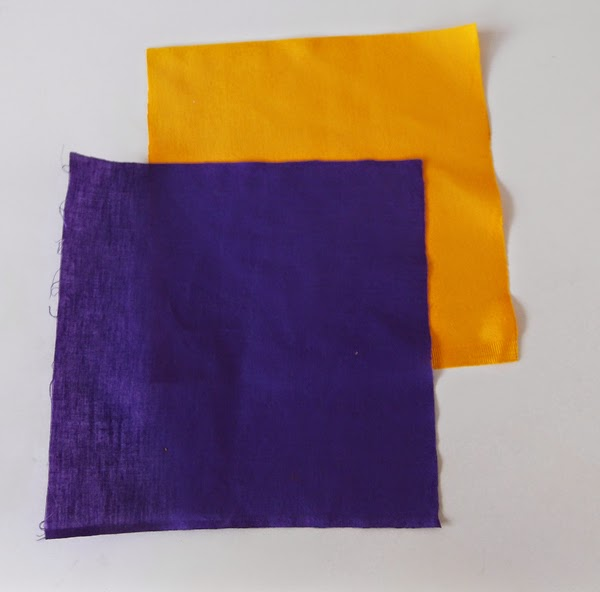 square pieces of fabric, pieces of fabric, purple fabric, orange fabric