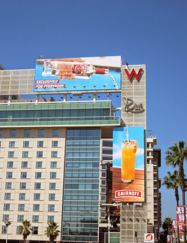 Pouring Smirnoff Vodka Exclusively for everybody billboards