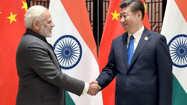 Image Attribute: Prime Minister Narendra Modi with Chinese President Xi Jinping meets on the sidelines of the 9th BRICS Summit in Xiamen on September 5, 2017. / Source: PTI