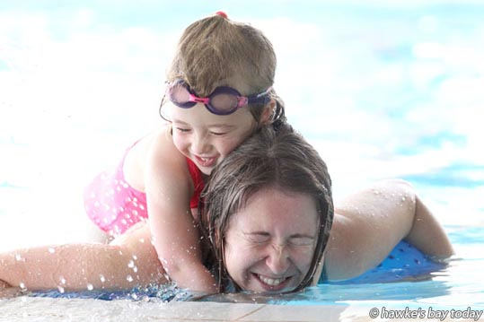 Vanessa Hayes, 4, Melanie Hayes, Dunedin, playing in the water at A. W. Parsons Heated Pool Complex, Waipukurau, in hot sunny summer weather.  photograph