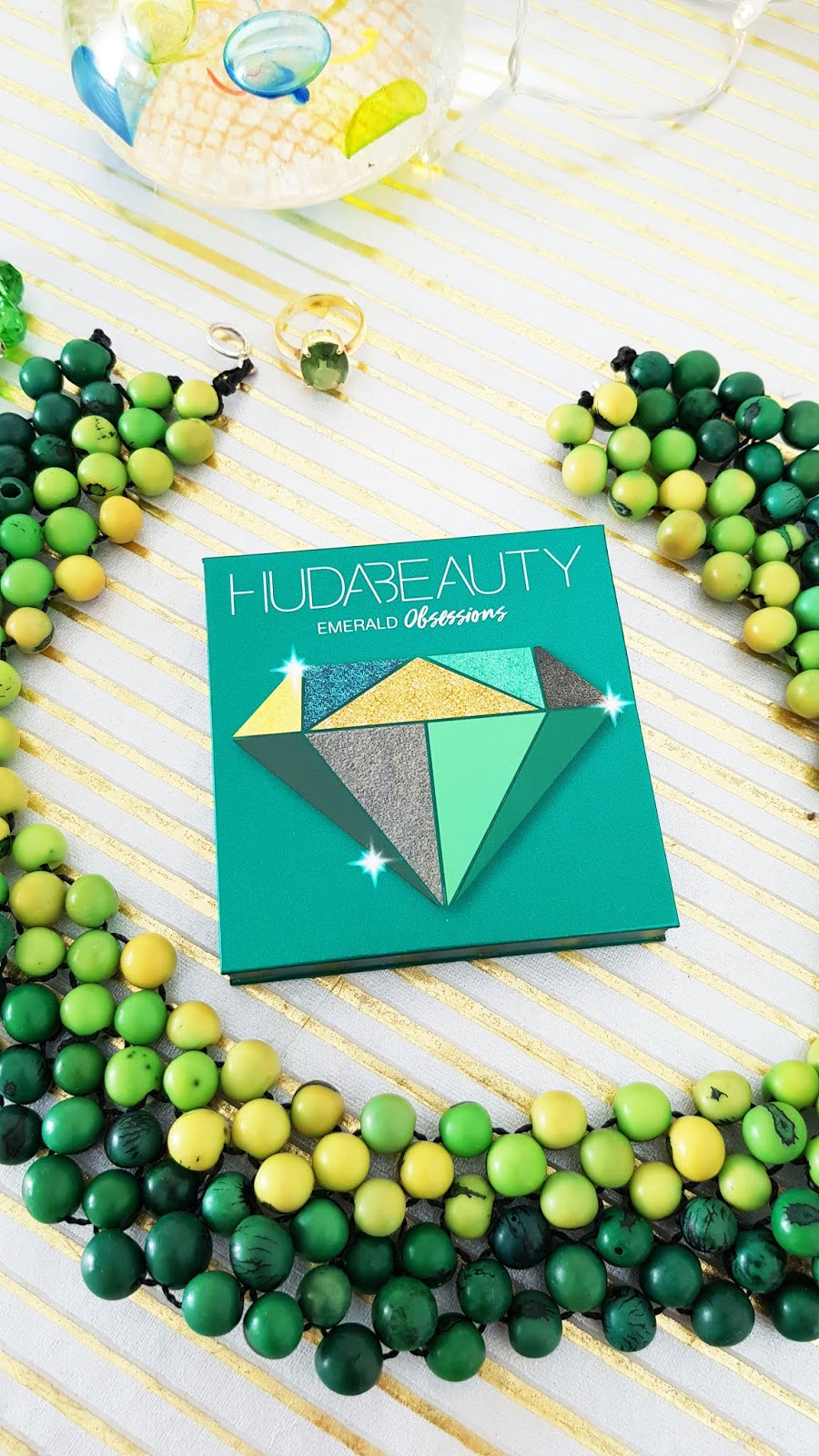The Huda Beauty Emerald Obsessions palette close up