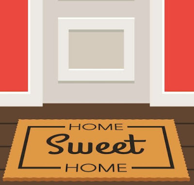 A home sweet home welcome mat in front of a white door on a red wall.