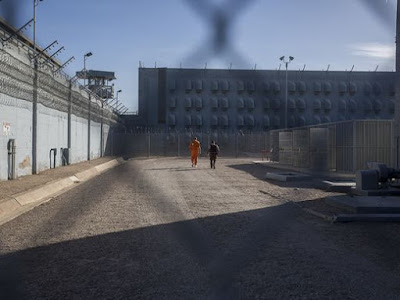 Richard Greenway (left), a death-row inmate, walks through the Arizona State Prison Complex-Florence on Nov. 22, 2017.