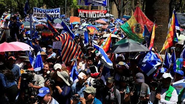 Bolivians celebrate President Evo Morales' decision to run for fourth term