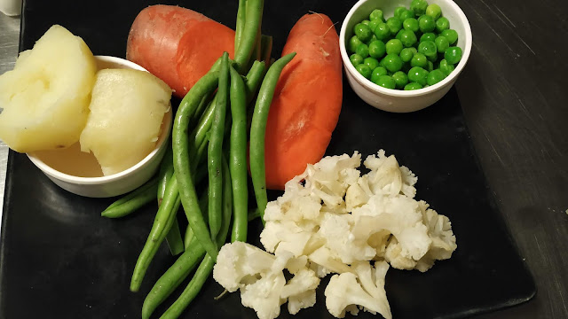 Carrot cauliflower green peas French Beans boiled potatoes food recipe