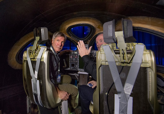 Actor and Pilot Harrison Ford listens to Virgin Galactic chief pilot Dave Mackay inside the new SS2.Virgin Spaceship Unity is unveiled in Mojave, California, Friday February 19th, 2016. Credit: Mark Greenberg/Virgin Galactic