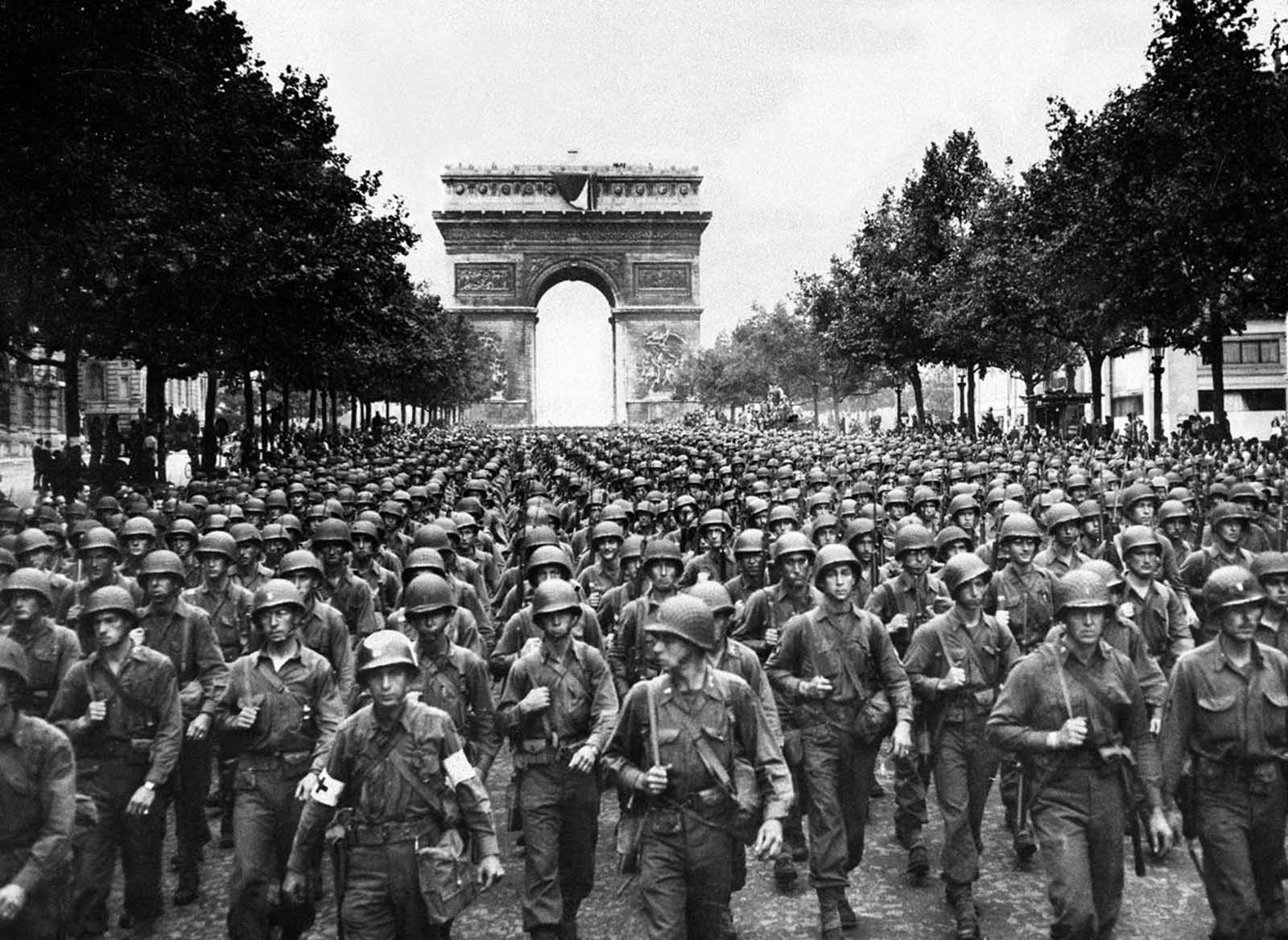 After the French Resistance staged an uprising on August 19, American and Free French troops made a peaceful entrance on August 25, 1944. Here, four days later, soldiers of Pennsylvania's Twenty-eighth Infantry Division march along the Champs-Elysees, with the Arc de Triomphe in the background.