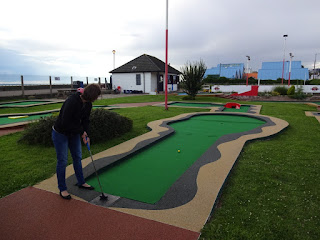Emily Gottfried Putting at the Arnold Palmer Crazy Golf course in Southend