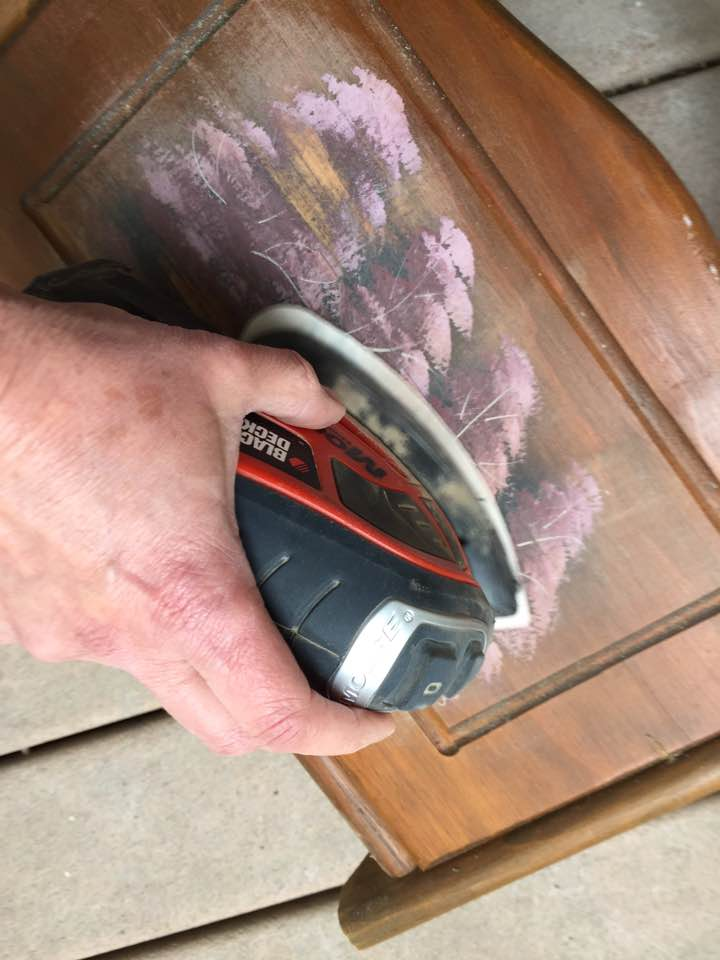 Mouse sander used to remove decorative paint.