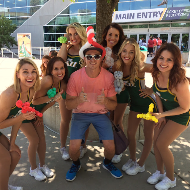 The Utah Balloon Artist posing with the Utah Jazz dancers after they all got balloon animals