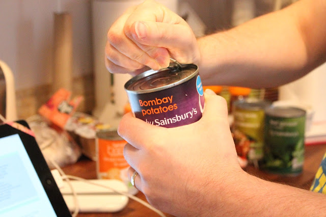 a can of bombay potatoes being opened