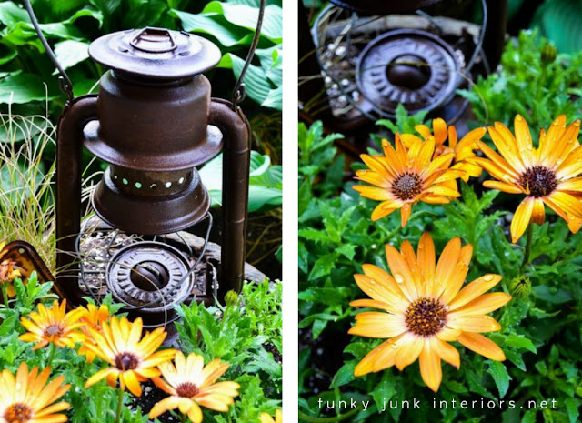flower barrel full of flowers and a rusty lantern