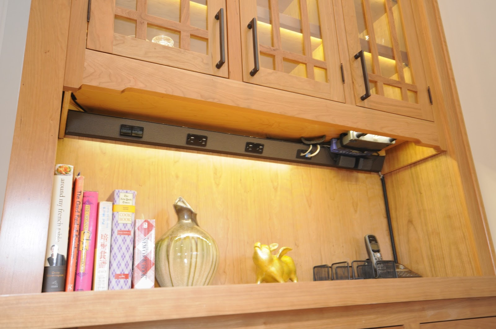 and phone, all concealed in a near invisible strip under the cabinets