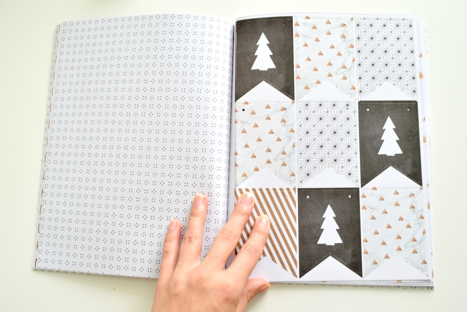 Christmas notebook with paper decorations.
