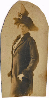 woman dressed in coat with fur trim and hat with bow northern California 1890s