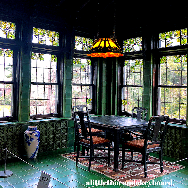 Magical breakfast room featuring Rookwood pottery tiles and Linden Art Glass windows at Glensheen in Duluth, Minnesota