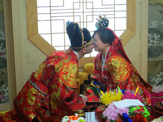 Traditional Korean wedding ceremony at wedding hall - eating dried dates