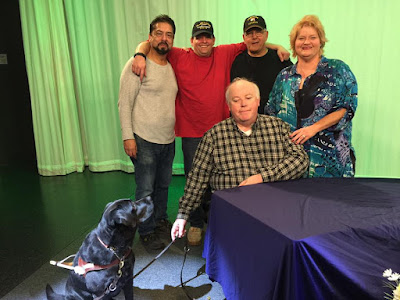 The crew of Blindside Fresno in a picture taken after the show. William Elliott (Producer) is seated beside Leif  his black Labrador retriever in guide dog harness, behind him are Rene Gomez (Camera) Ace Dunn (Director) and Steve Manelski ( Camera  on far right is Darcie Elliott (Host).
