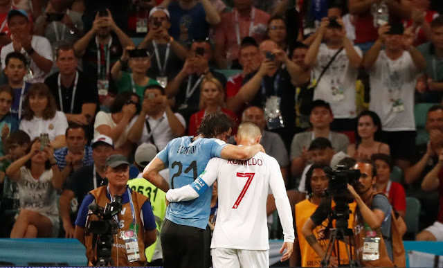 Cristiano Ronaldo helps injured cavani off the pitch during uruguay vs Portugal at Russia 2018 world cup