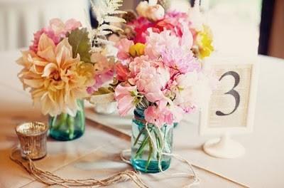 4 Flores em garrafas...!