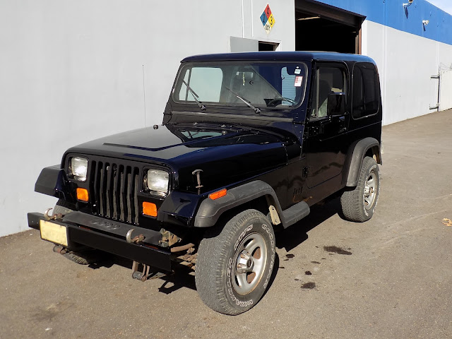 Jeep Wrangler after new paint job at Almost Everything Auto Body.