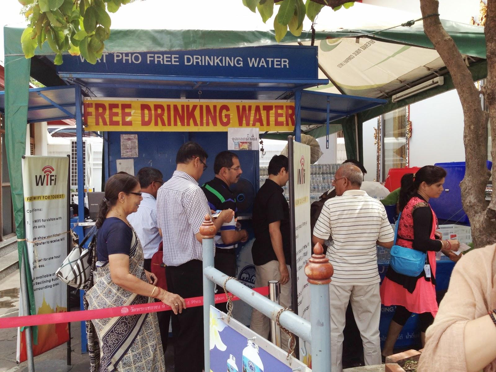 Bangkok - Tourists get free drinking water at Wat Pho