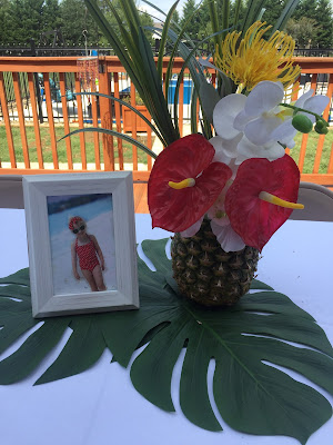 Lilo and Stitch theme birthday party - How to throw a Lilo and Stitch inspired Hawaiian Luau. Food and drink table decoration ideas. Pineapple centerpiece
