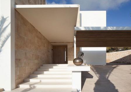 rumah minimalis dengan batu alam tempel