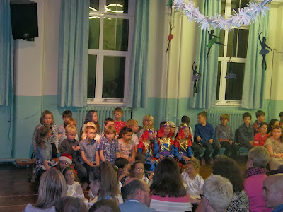 kids in school play wise men shepherds angels nativity in front of parents
