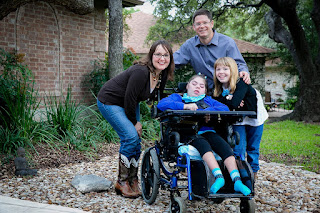 Picture of Borden family with Savannah in her wheel chair