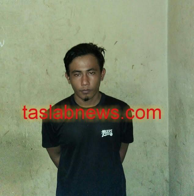 (Ignatius siagian.taslabnews)  Tersangka Maradona Panjaitan alias Dona saat diamankan di Polsek Tanjungbalai Selatan, Resor Polres Tanjungbalai, Rabu (1/8).