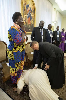 Pope kisses feet of South Sudan's leaders to encourage peace.