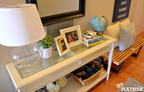 Front Hallway Table with lamp keys and books on it