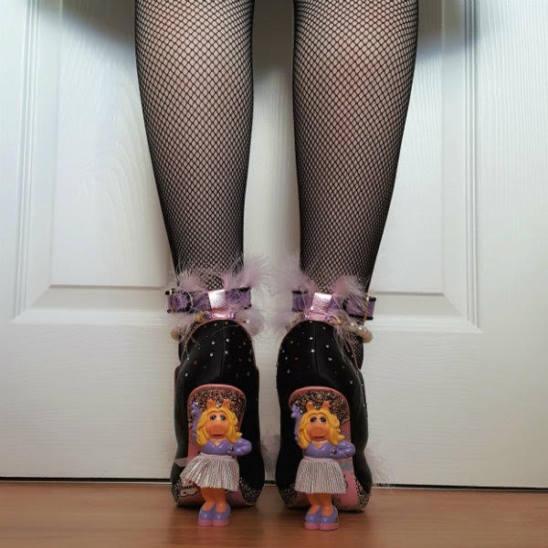 wearing Miss Piggy heeled shoes