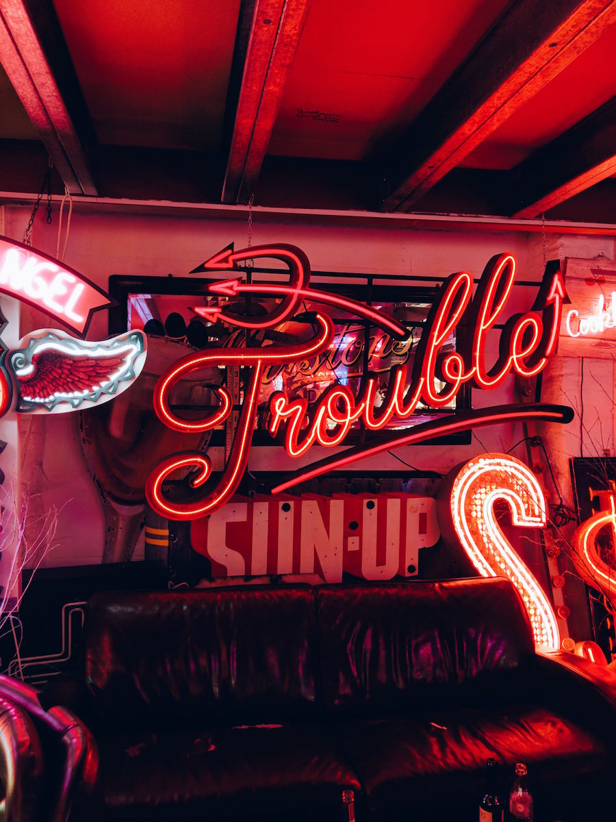 Neon Trouble sign sits in the Rolling Scones cafe