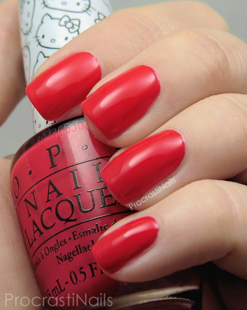 Swatch of OPI 5 Apples Tall a bright apple red creme nail polish that leans ever so slightly slightly pink