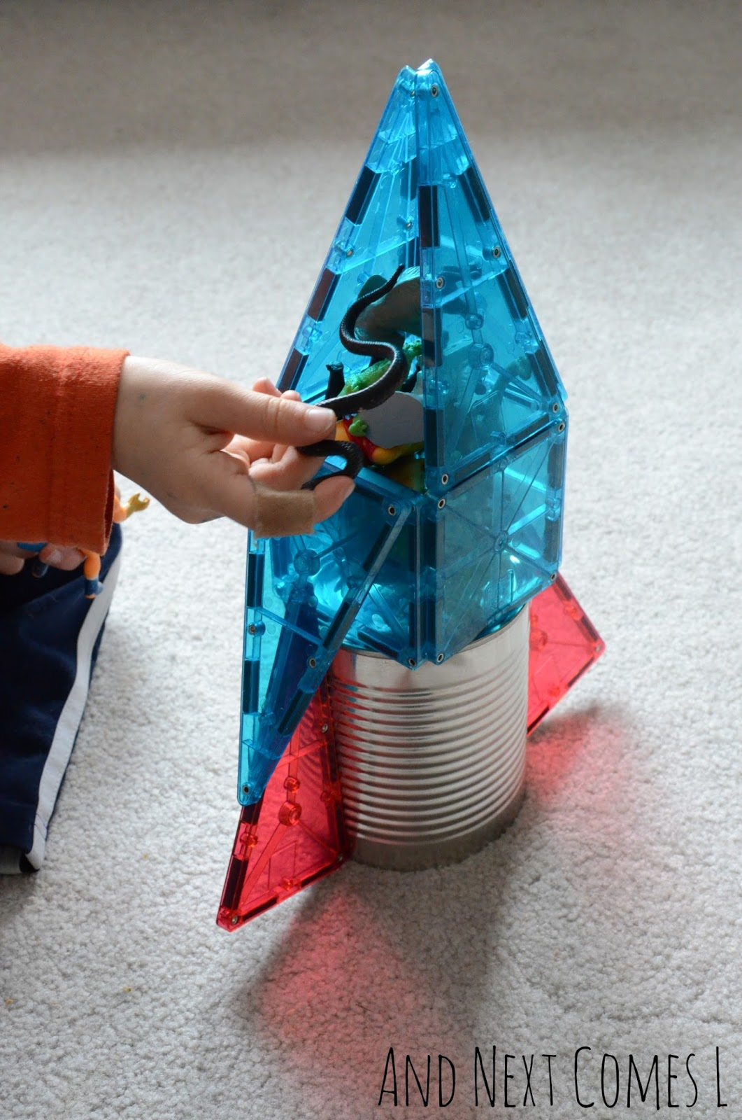 Loading the passengers into a tin can and Magna-Tiles rocket from And Next Comes L