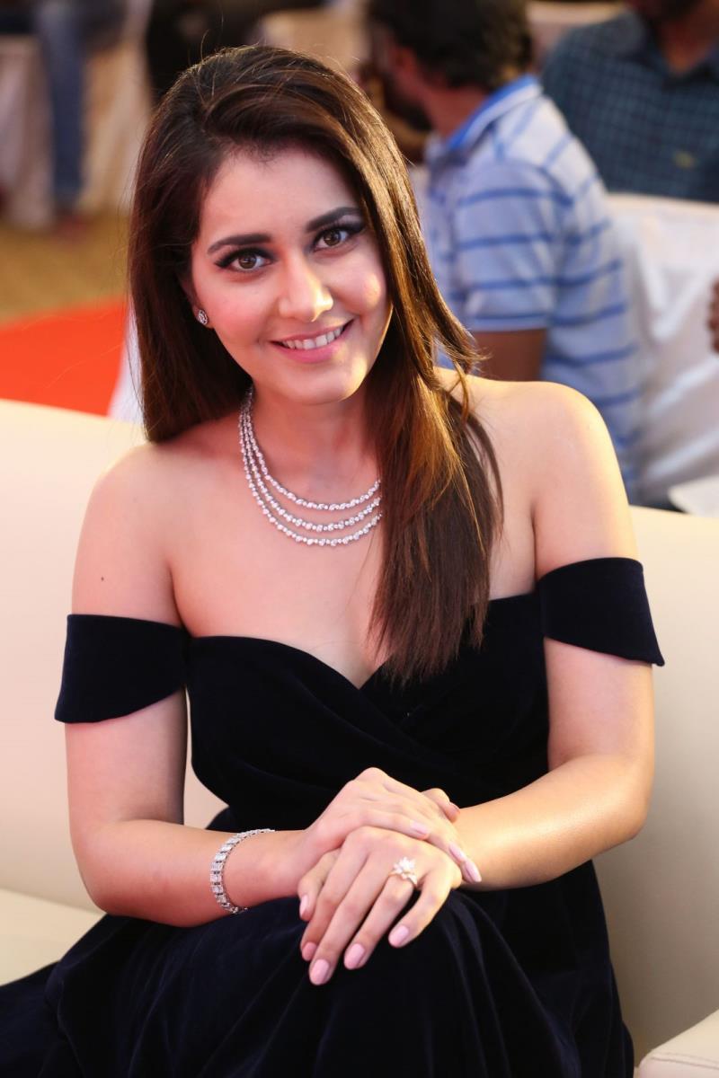 tollywood actress rashi khanna chubby face long hair stills in blue