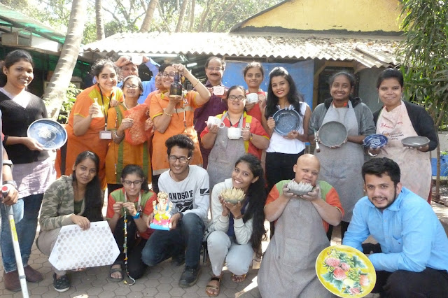 Happy Faces - volunteers and specially-abled posing with their finished products