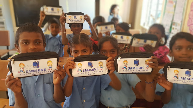 Pic- 3 Government school students rejoicing after receiving School Kits from Samsung