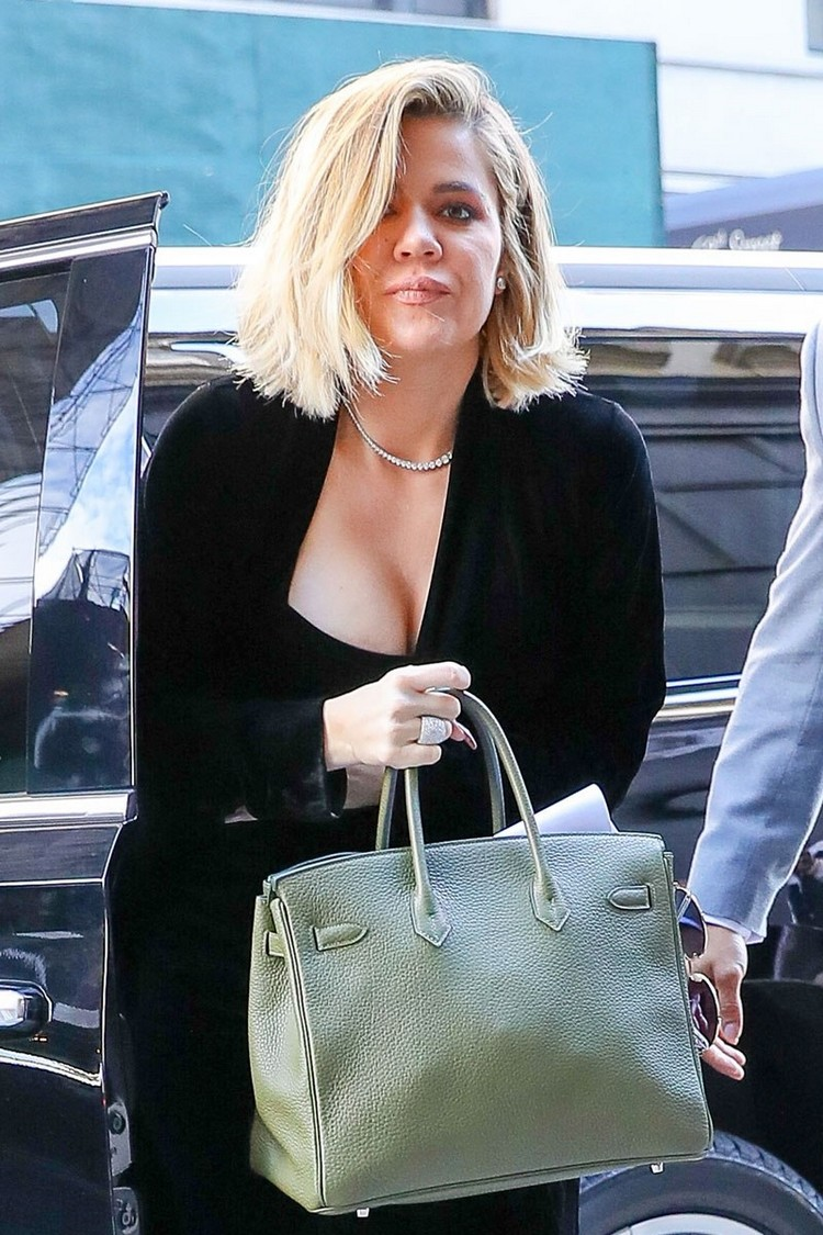Khloe kardashian places being pregnant boobs on full display after rumors swirl that she's watching for a boy