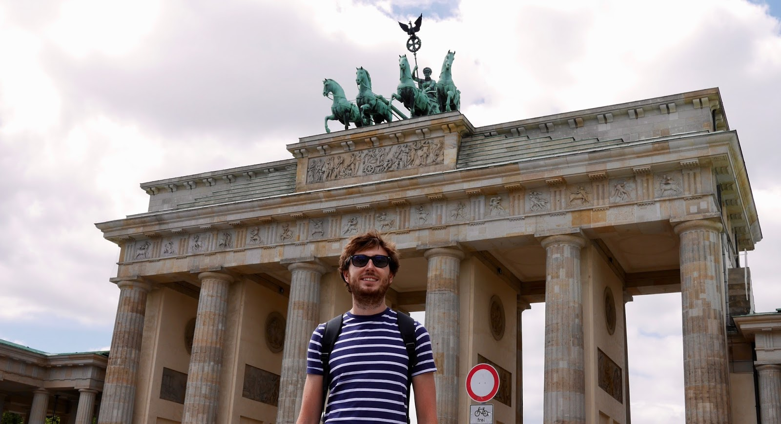 Cal Mc standing at the Brandenburg Gates, by www.CalMcTravels.com. Cal McTravels