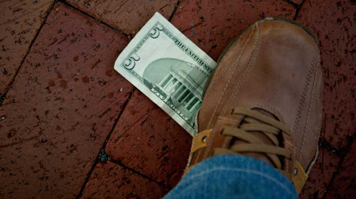 In Thailand it is illegal to step on money